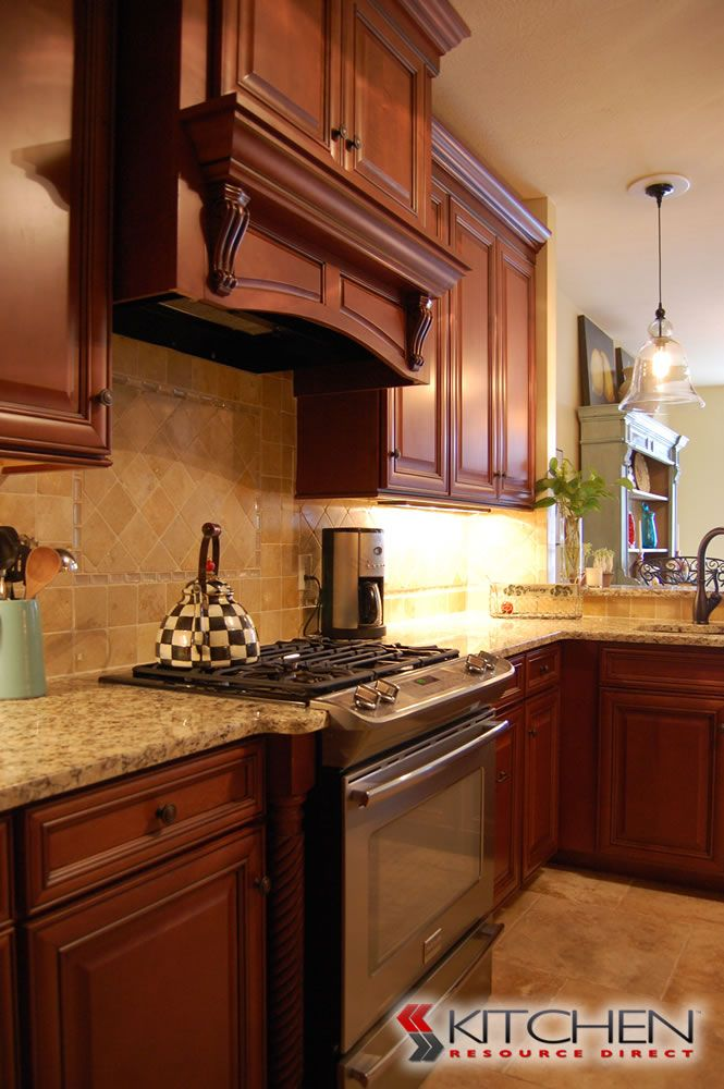 Beautiful traditional kitchen with medium stained cabinet