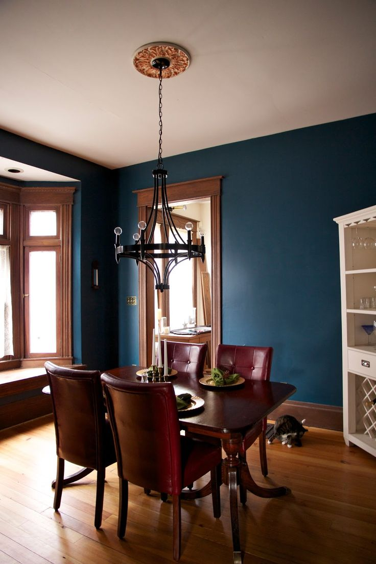 Dark teal wall paint and unpainted wooden trim for the dining room  Dining room  Pinterest