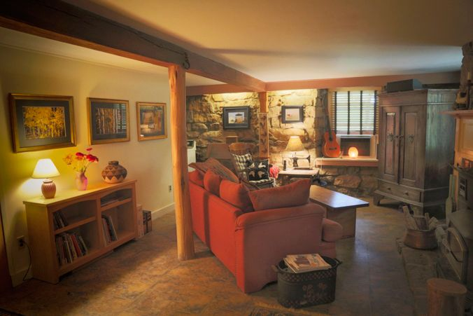 The stone walls surround the large living room a favorite