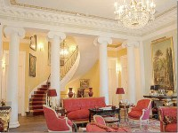 living room with columns and staircase   Interior Design ...
