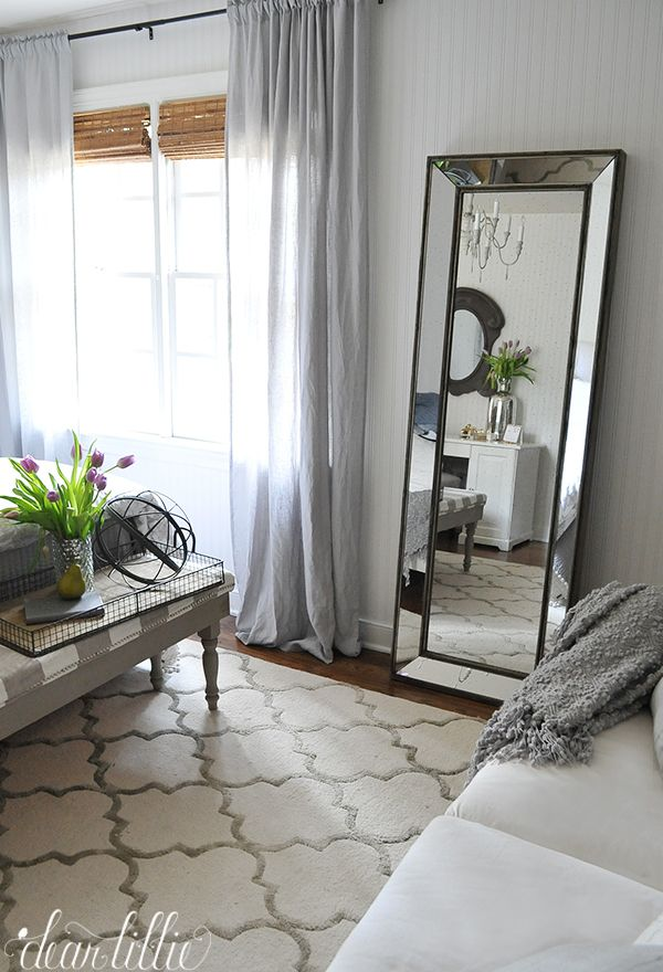 This tall standing mirror from HomeGoods is a great accent