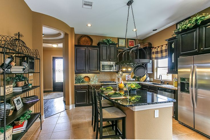 Gehan Homes Kitchen Yellow Wall Color Stainless Steel Appliances Black Granite Black
