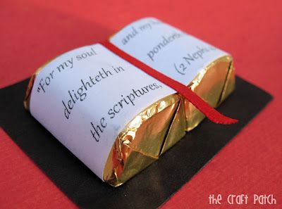 Two little Hersheys Chocolates attached to a black piece of paper…print verse out and attach to wrappers to look like the Bible! Add a piece of red ribbon for the bookmark! Such a cute