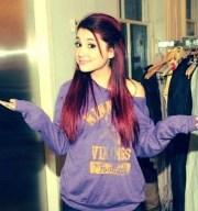 purple sweater. ariana grande