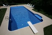 Beautiful Rectangle pool with a brushed concrete deck ...