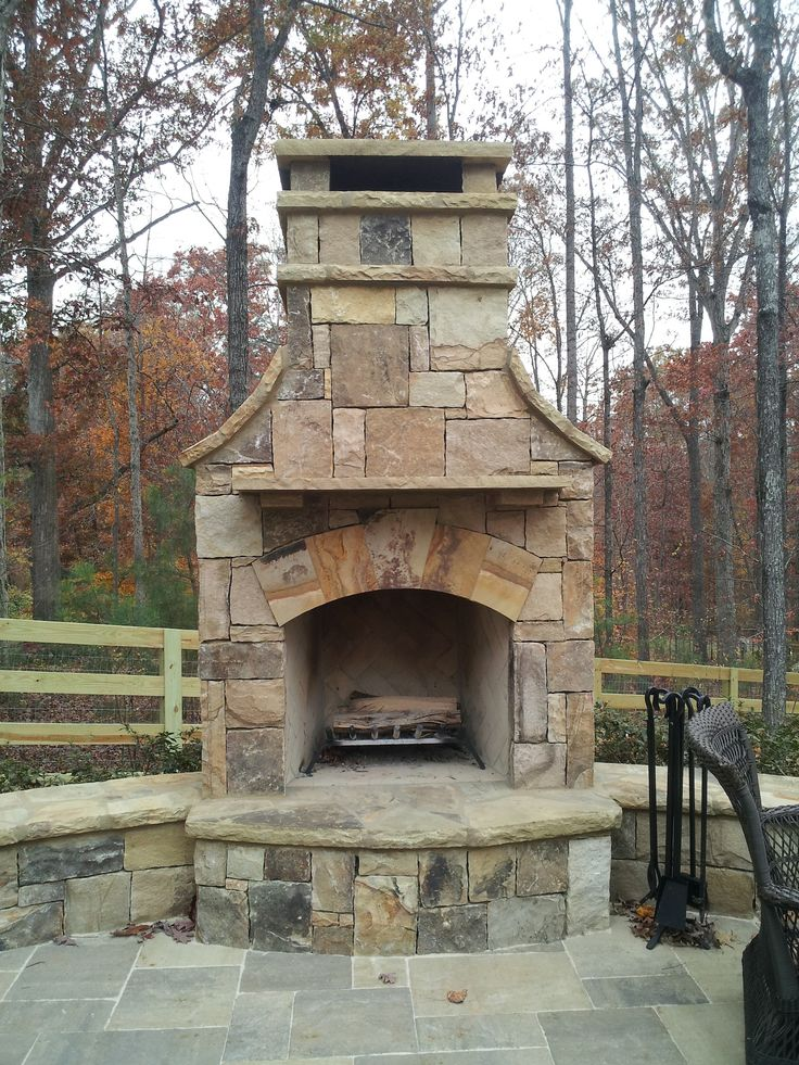 Outdoor Stone Fireplace with Hearth and Seating Wall