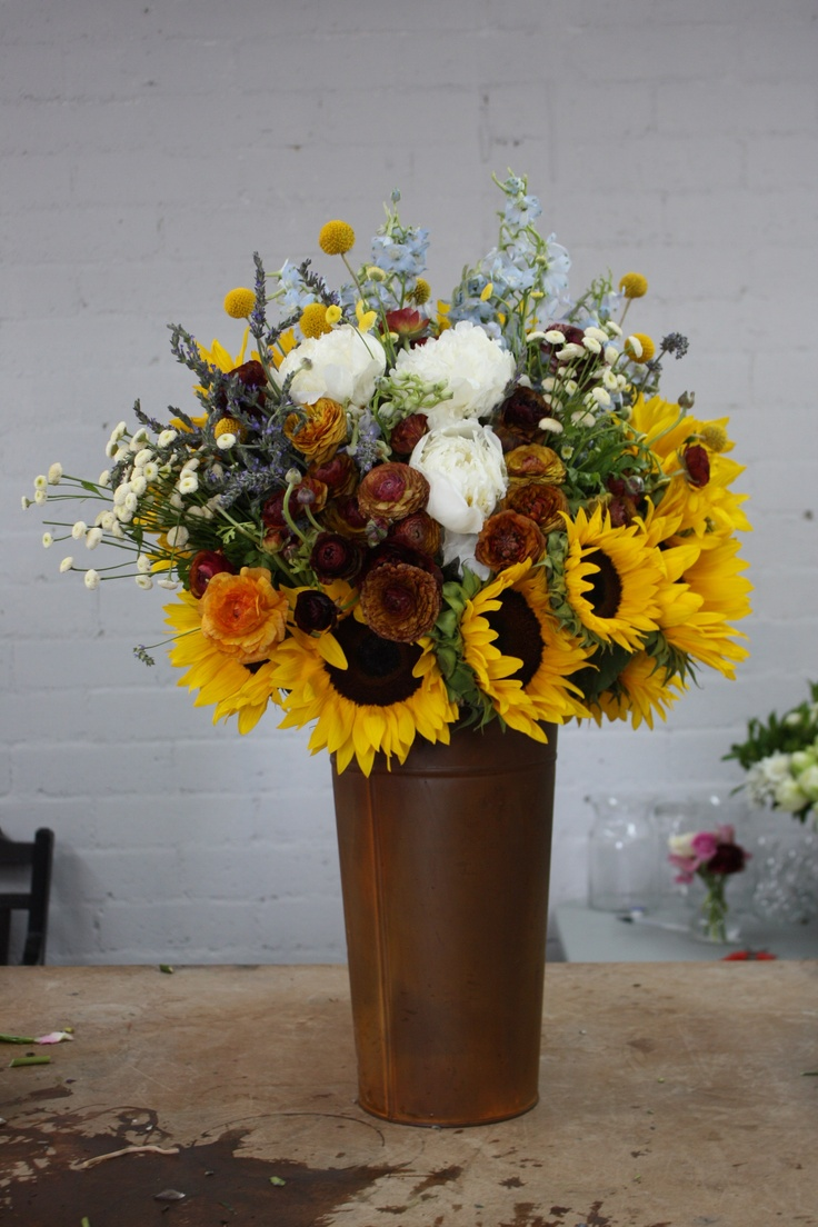 A Southwestern style floral arrangement in a rusty pale