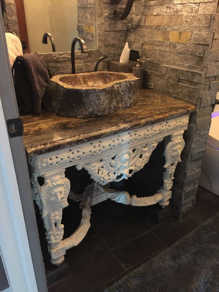 Our castle old world powder room with stone from Floor  Decor used to frame mirror and walls in