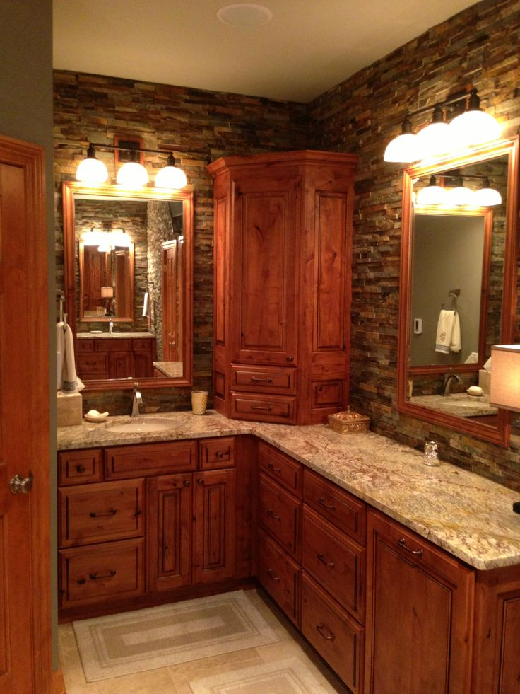 Elegantly rustic master bathroom with drystacked stone