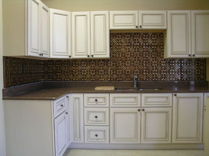 Copper tin backsplash and distressed white cabinets  The Dragonfly House Dixie Lane