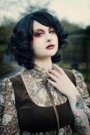 noir black short curly bob hair makeup