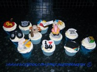 80's themed cupcakes, with captain cave man, lego, he man ...