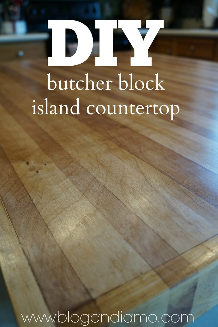 white kitchen island with butcher block top tiles size diy countertop using a sheet of ...