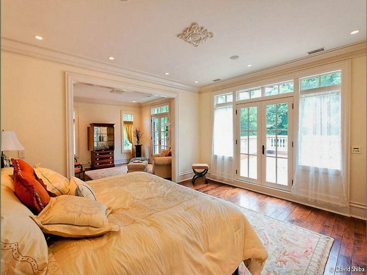 Master bedroom with french doors leading to patio terrace