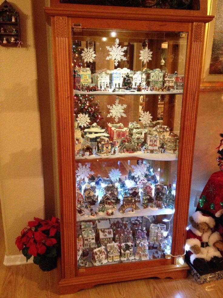 Christmas village in my curio cabinet  HolidayChristmas  Pinterest  Christmas villages