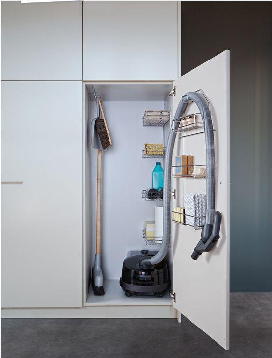 Vacuum cleaner storage cabinet