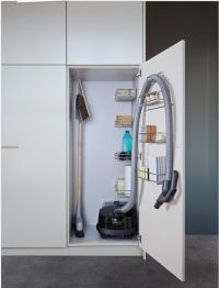 Vacuum cleaner storage cabinet