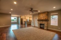 wood floors with carpet piece.