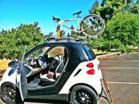 Smart Four Two featuring a Thule rooftop bike rack | Car ...