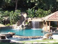 Gorgeous pool! There is a rock grotto, slide, swim up bar ...