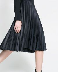 I wonder how this coated skirt looks and feels irl. Love ...
