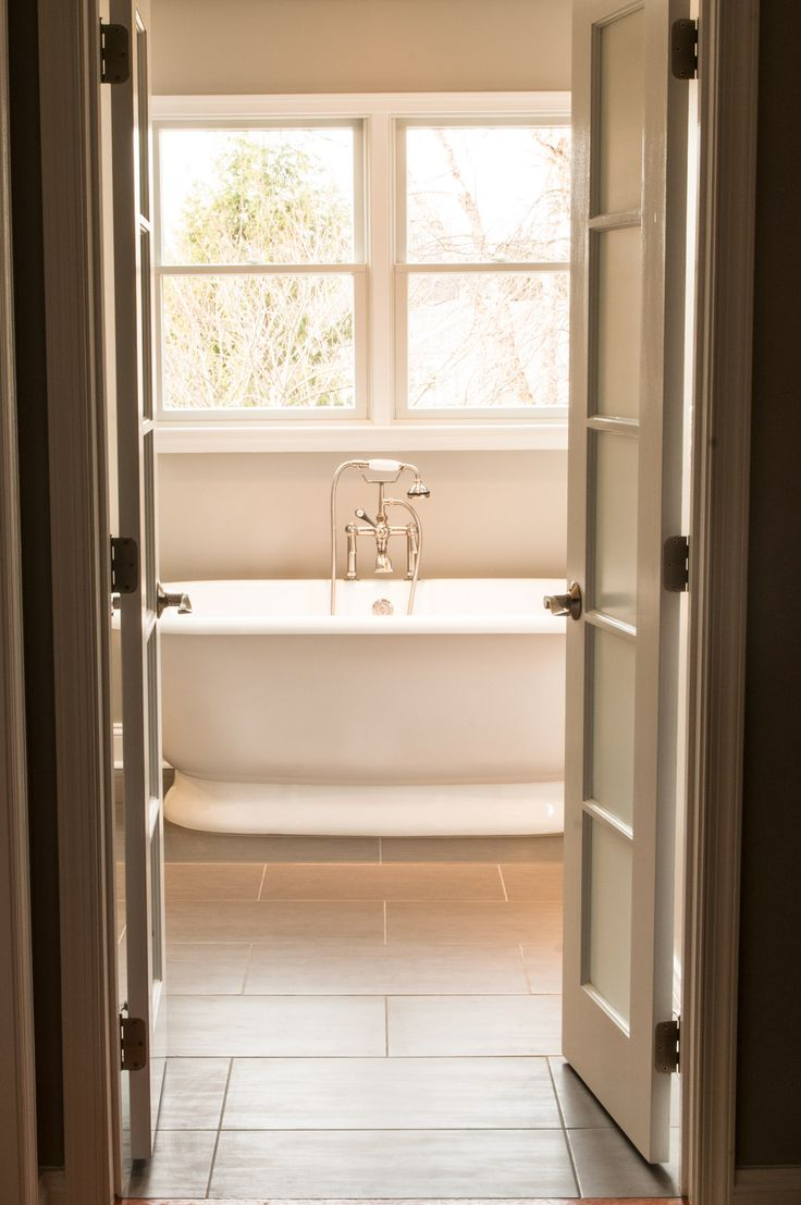 Cool White Double Swing Bathroom Doors Feat Oval Free Standing Porcelain Tub In Classy Bathroom