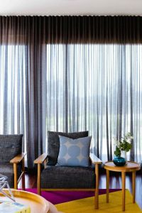 Jan15-window-treatments-sheer-grey-curtains-retro-living ...