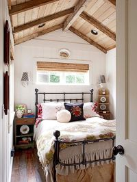 This petite bedroom overflows with character and charm. An ...