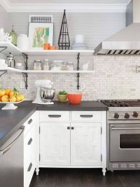 Grey countertops (edge cut), white cabinets, marble ...