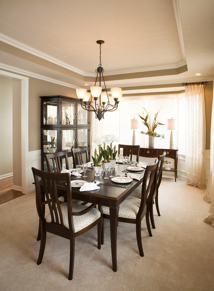 Formal dining room with large windows  Stanford Home
