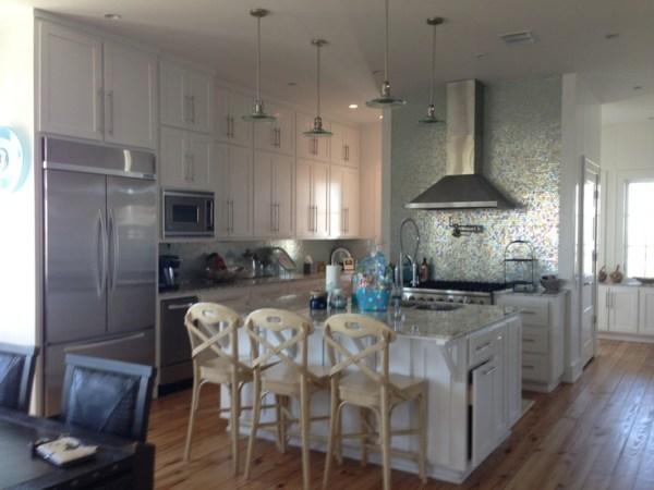 beach house kitchen backsplash Really like the pendants lights. Beach House Kitchen nice