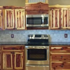 Clean Kitchen Cabinets Island With Table Attached Rustic Red Cedar Cabinets. Modern Frontier Log ...
