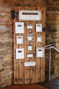 Rustic wedding, table plan, barn door, Cadbury's table ...