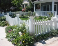 White picket fence with decorative corner posts. #white # ...