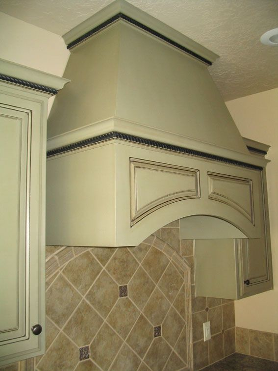 sage green kitchen cabinets  Sage green arched exhaust