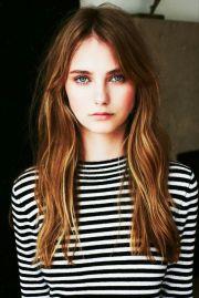 dark brown hairs with green eyes