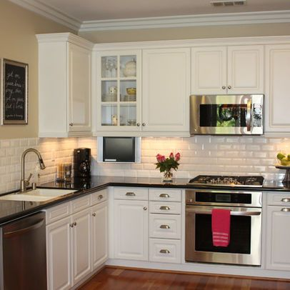 white kitchen cabinets with subway tile backsplash White cupboards, black counters, Subway Tile. Just missing