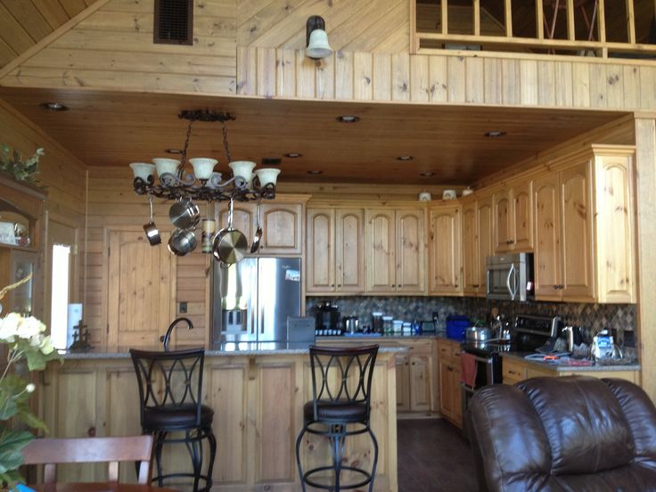 Kitchen with pine cabinets pine tongue and groove walls