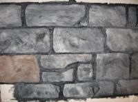 Faux stone wall from foam sheet, painted. After using heat ...