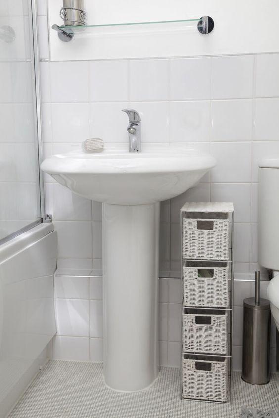 White Pedestal Sink With Nearby Wicker Storage  httpwalkinshowersorgbestpedestalsink