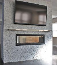 Interior. silver steel mantel shelf under rectangle black ...