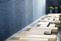 Wood stepping blocks, concrete wall