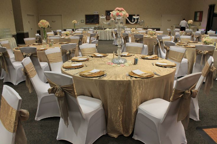 Champagne crushed taffeta tablecloths and chair sashes