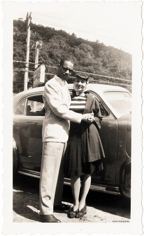 1940s couple war era photo man and woman near car mixed suit dress vintage fashion style print