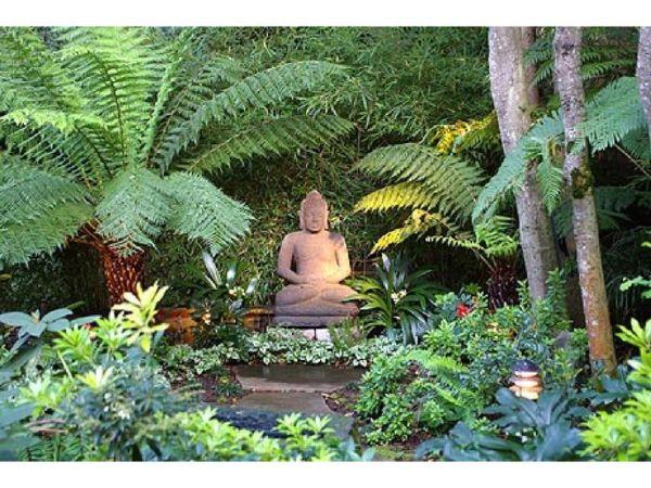 buddha statue in garden setting
