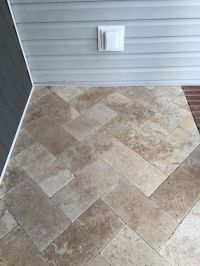 We used travertine tile in the herringbone pattern for our ...