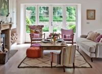 Traditional living room with mismatched chairs...furniture ...