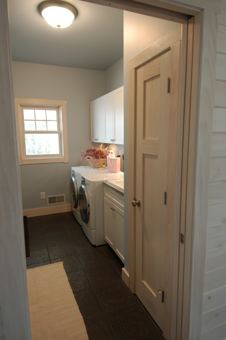 One side of the Laundry Room with a front loading washer