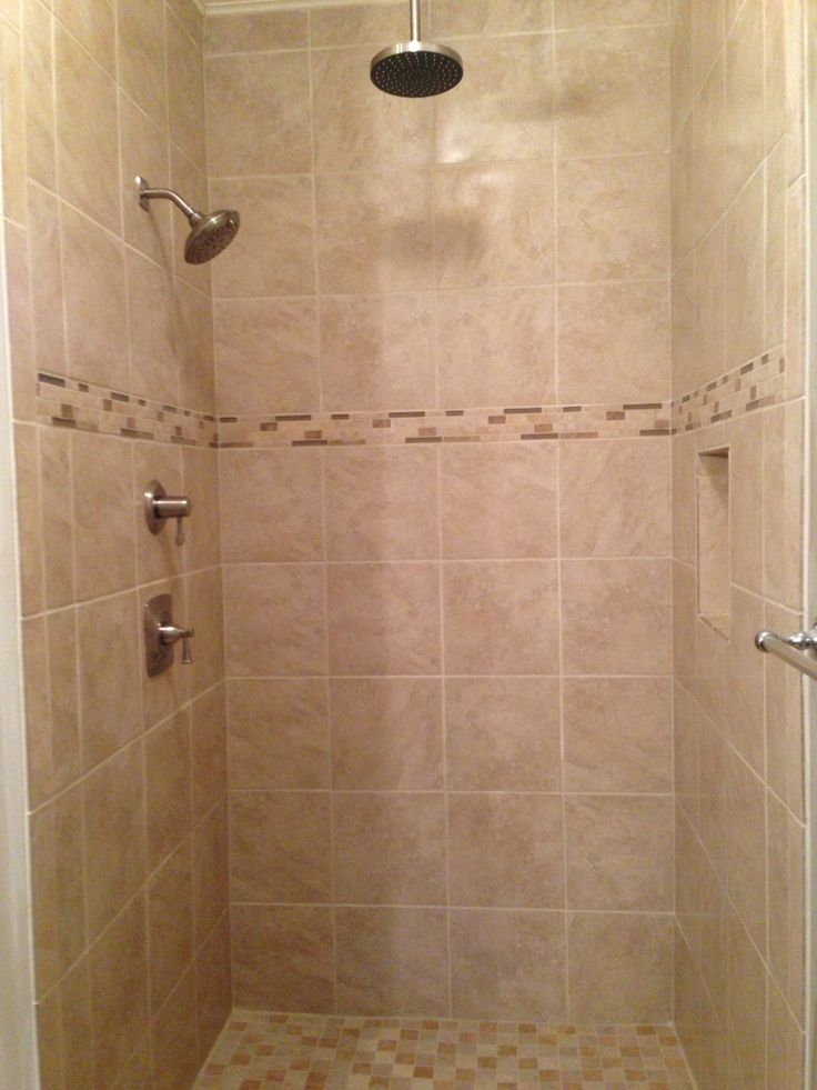 Light beige tile shower with rain head shower fixture