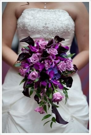 A mix of purple flowers in this bouquet Use purple roses black calla lilies blue hydrangeas